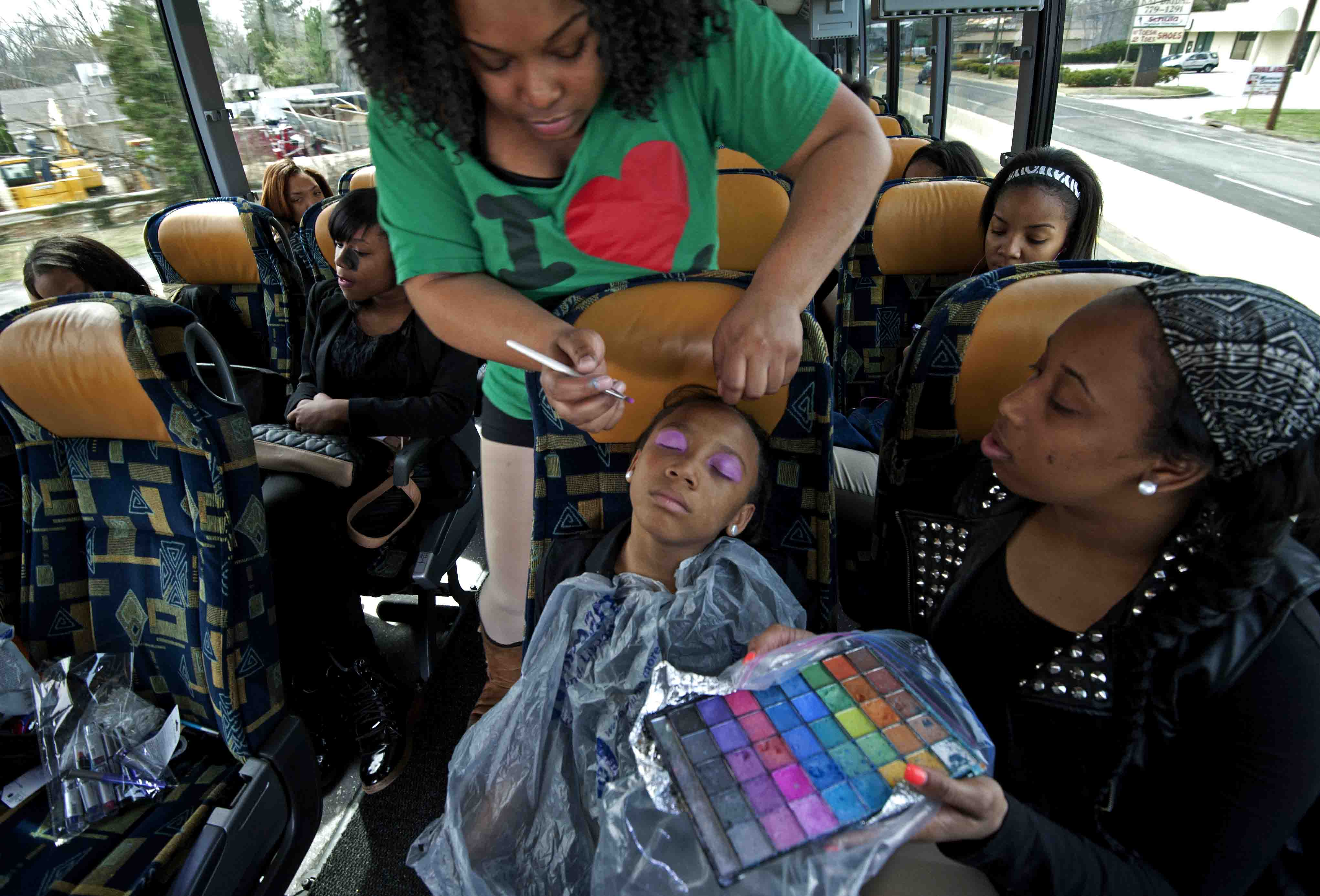 1. Members of the team get made up on the way to a taping in New York City. / 2. The team waits nervously to appear on Dancing with the Stars in 2013.