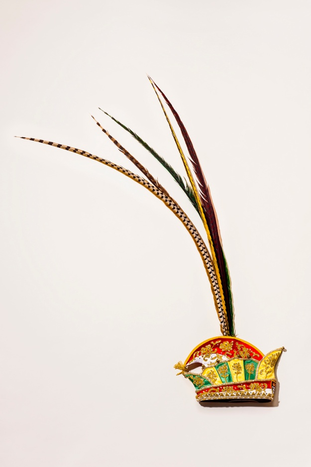 1. The prince's special headpiece is adorned with four pheasant feathers; red and white for Cologne and yellow and green for the carnival. / 2. The regalia jacket is tailor-made for each prince.