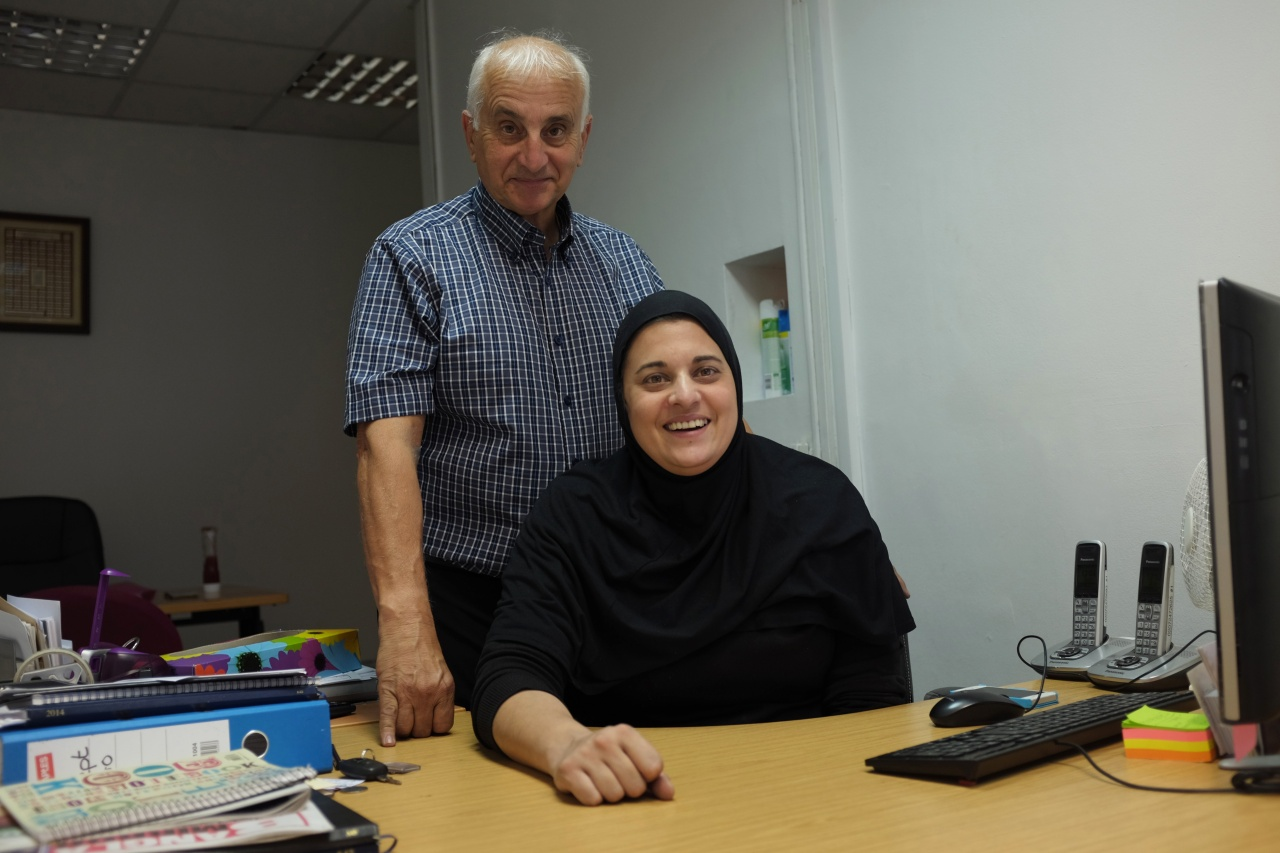 Gulam Taslim and his daughter Habiba inside the offices of Haji Taslim Funerals in east London.