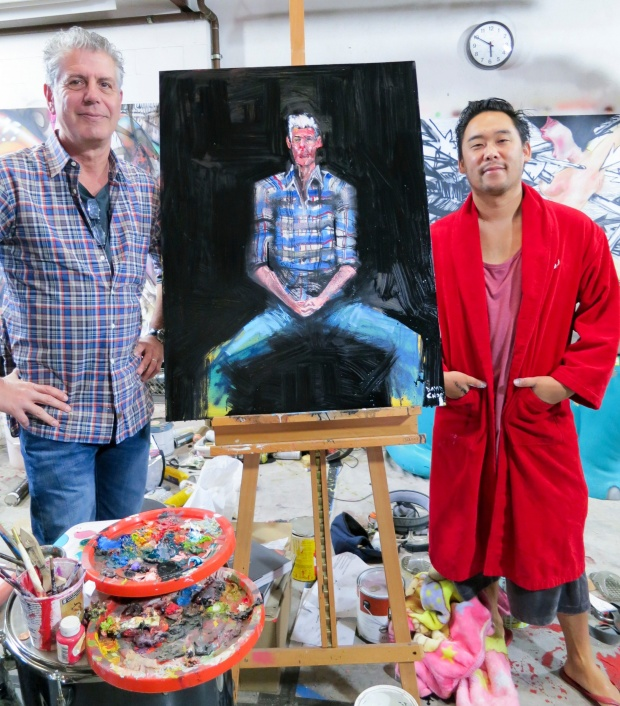 Bourdain posing with David Choe.