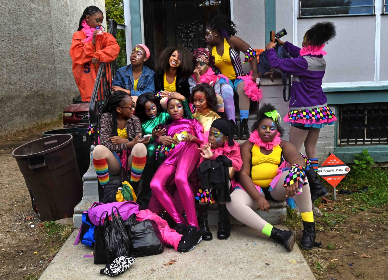 The Sophisticated Sisters relax on Tawanda Jones's doorstep in Camden before a performance.