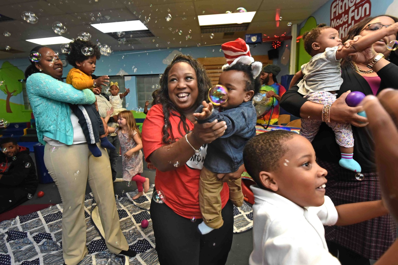 Tawanda Jones with the youngest of her four children, Re'Kye, at his first birthday party last year.