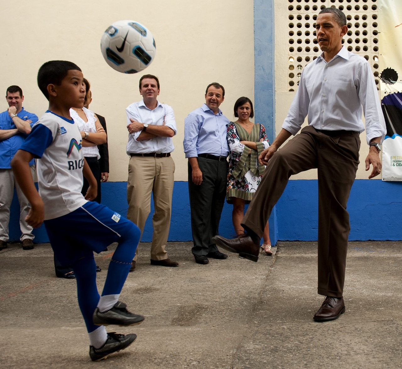 "U.S. President Barack Obama plays soccer while visiting the ""City of God"" favela in Rio de Janiero, Brazil, on March 20, 2011. (Saul Loeb/Getty Images)"
