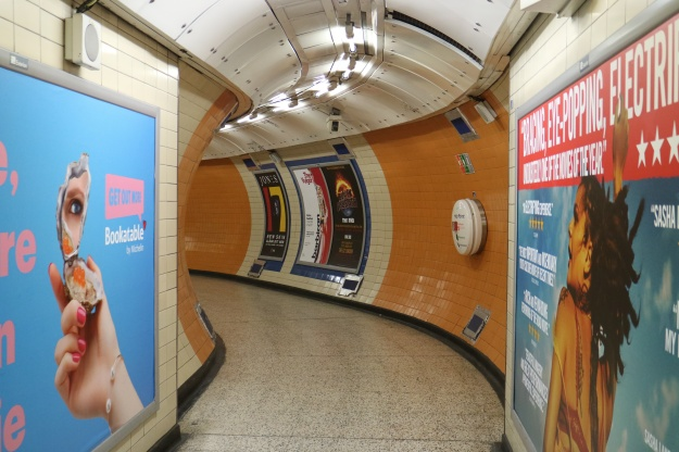 1. McDonalds-wielding Night Tubers on the escalators. / 2. Billboard tunnel at Tottenham Court Road station.