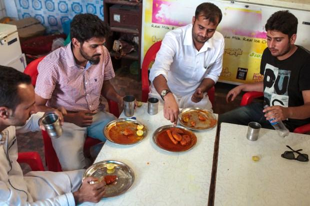 Tourists from Jammu enjoy wazwan at the New Zum Zum Hotel.