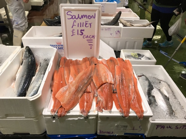 1. Salmon fillets at Billingsate Fish Market. / 2. Traders at Billingsgate Fish Market.