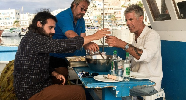 1. Bourdain and Lambros Tryfillis enjoying a drink / 2. Bourdain dines with the in-laws of the regional governor.