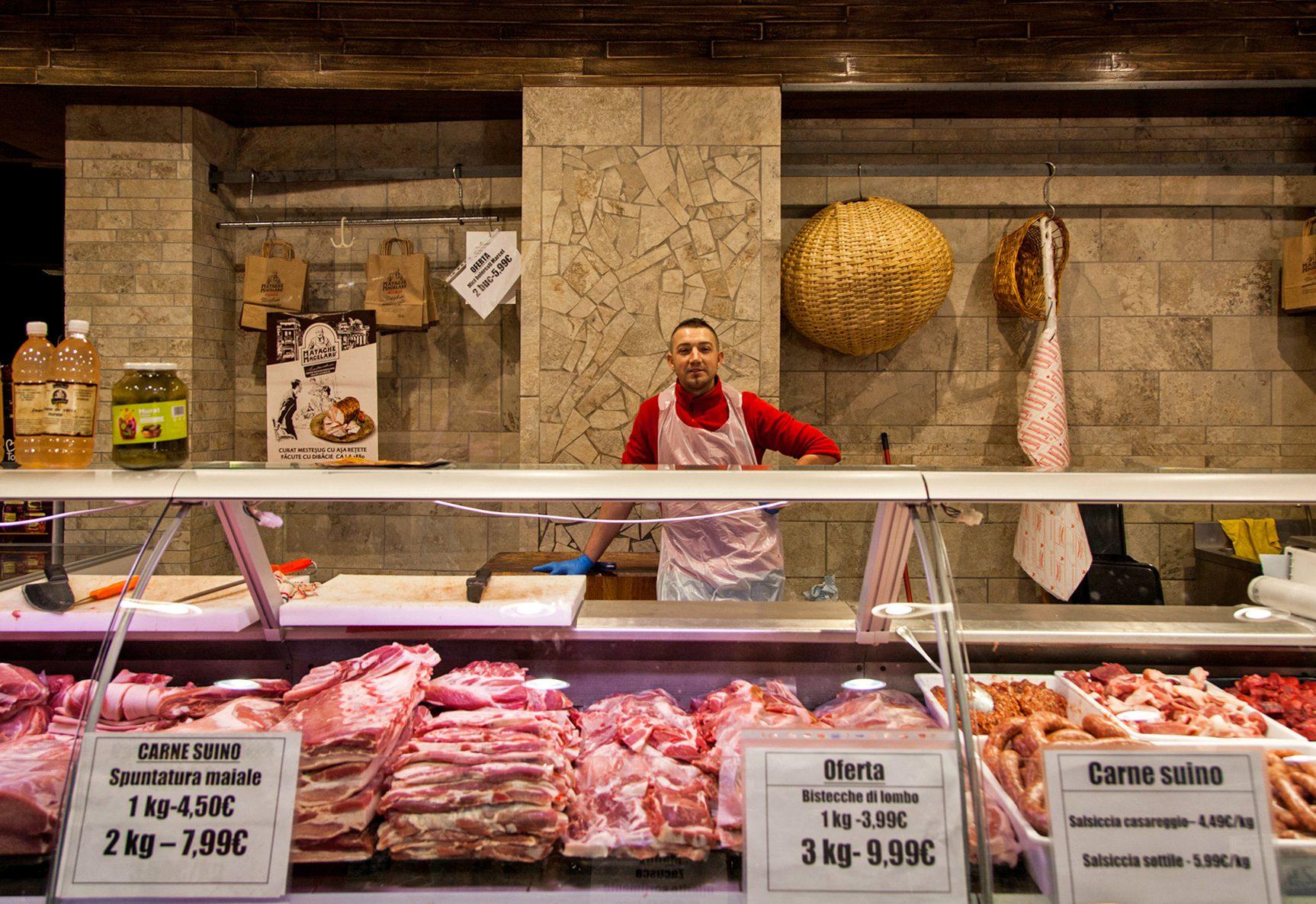 Tiberius Vasile poses for a portrait at the Romanian supermarket La Strada.