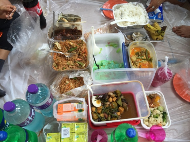 The lunch spread, including pancit noodles, chicken adobo, pinakbet stew, and buko pandan dessert.