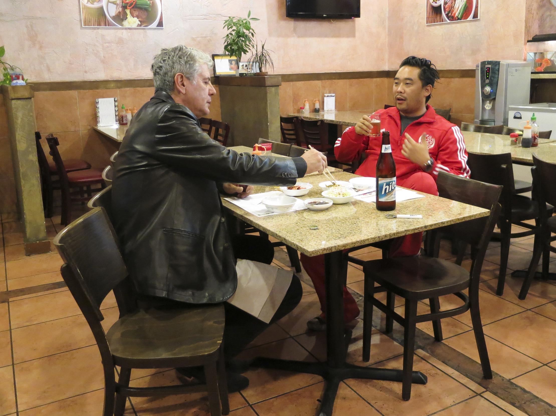 Bourdain eating with David Choe at Myung In Dumplings.