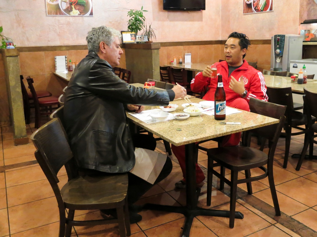 Bourdain eating with David Choe at Myung In Dumplings.