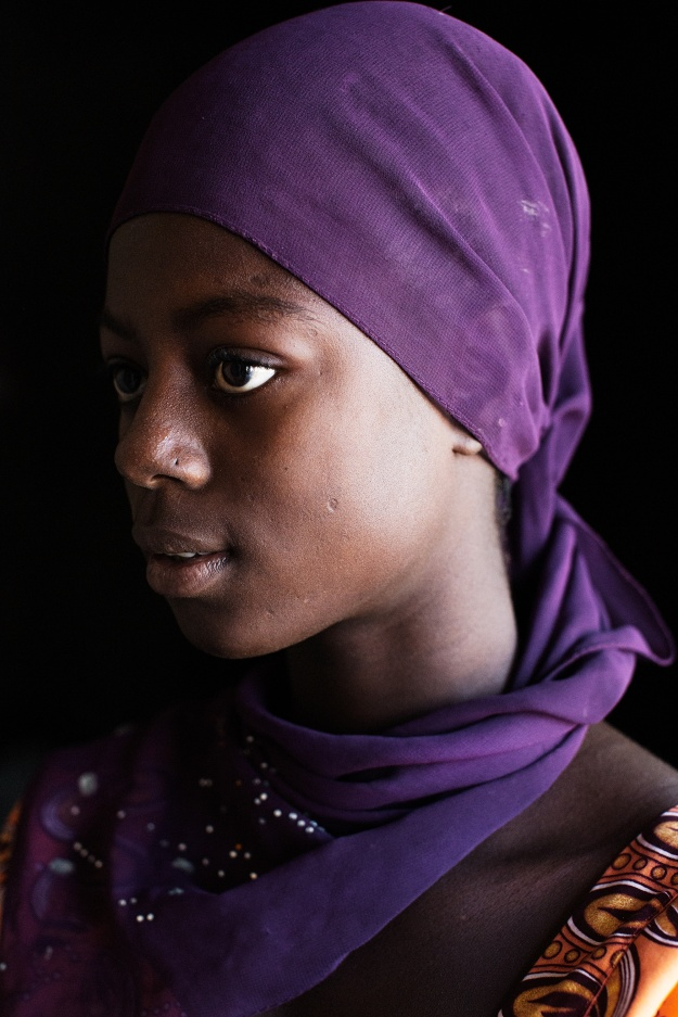1. Yamou Kante, from Medina Diambere Village, at age 15. Yamou was unsure as to what to do when her parents wanted her to get married at age 13 to a man in a neighboring village. She spoke with the elders and confronted her parents, who agreed to allow her to wait until she was older. / 2. Aissatou Diallo, from Medina Diambere Village, at age 14. Aissatou did not know the man that her father wanted her to marry, but she knew she was too young, and that she wanted to continue pursuing her studies. Her mother, a member of the Grandmother Project in their village, was her confidante, and after much convincing was able to talk her father out of handing Aissatou off to a stranger.