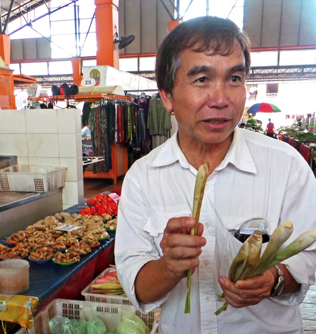 Joseph Daniel shopping in Satok Market. (Photo by Mark Hay)