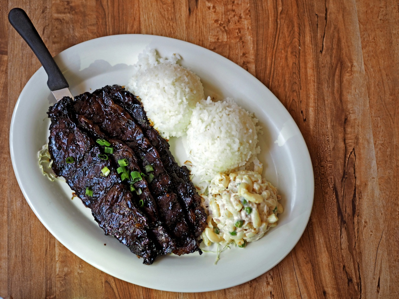 A Korean-Hawaiian plate lunch of kalbi, rice, and macaroni salad.