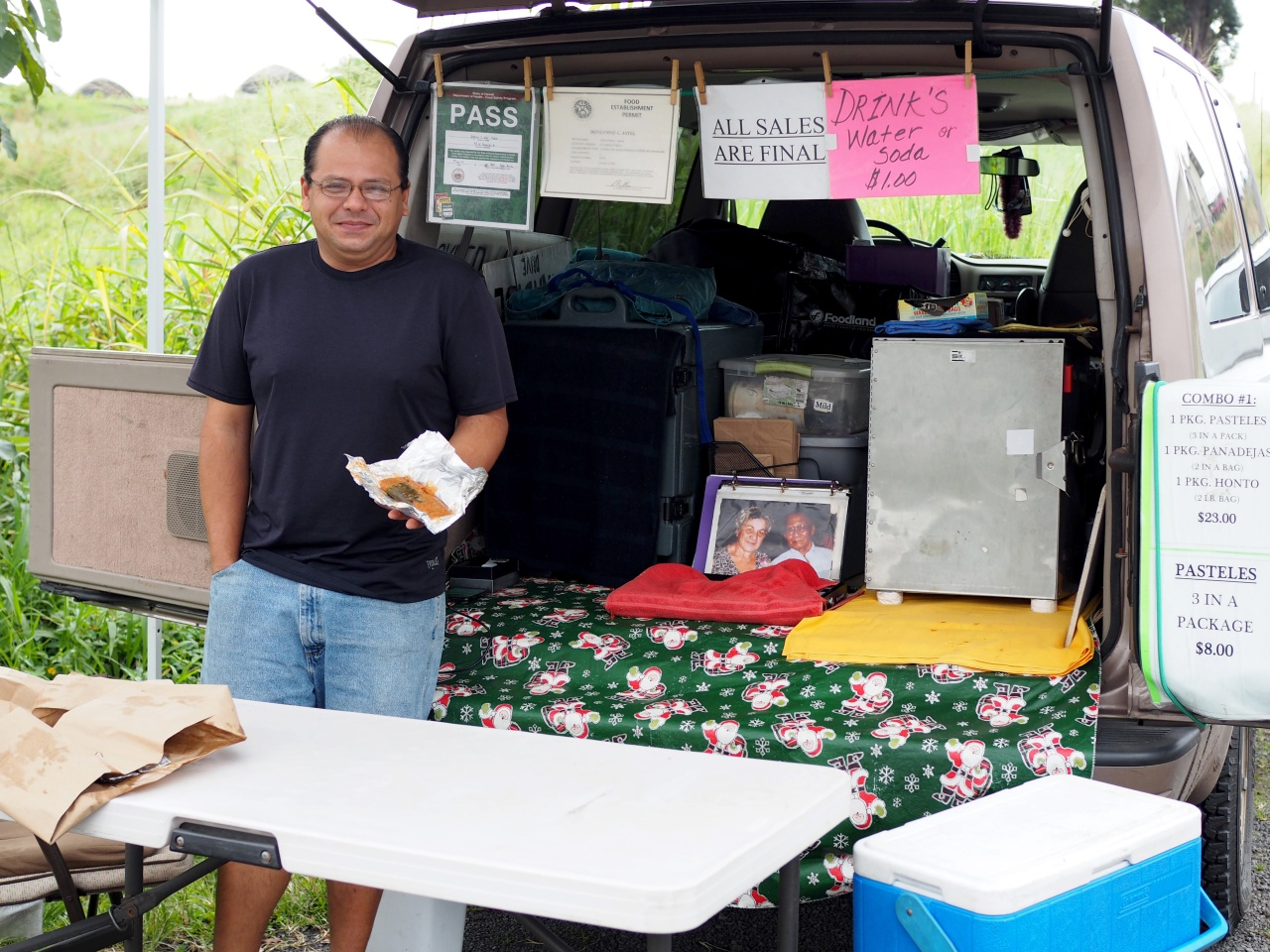 Benlynne Astel's son at their roadside Puerto Rican food stall.