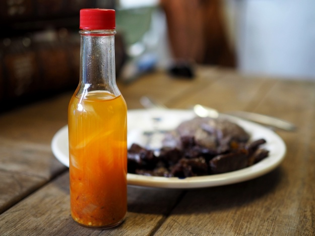1. Chili pepper water commonly eaten with pipi kaula. / 2. Pipi kaula served with poi, onion, salt, and chili pepper water.