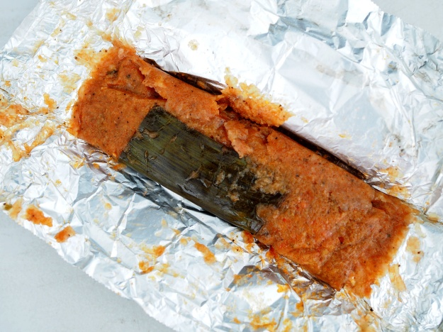 1. The tamale-like pasteles are a local favorite. / 2. Annatto-colored gandule rice.