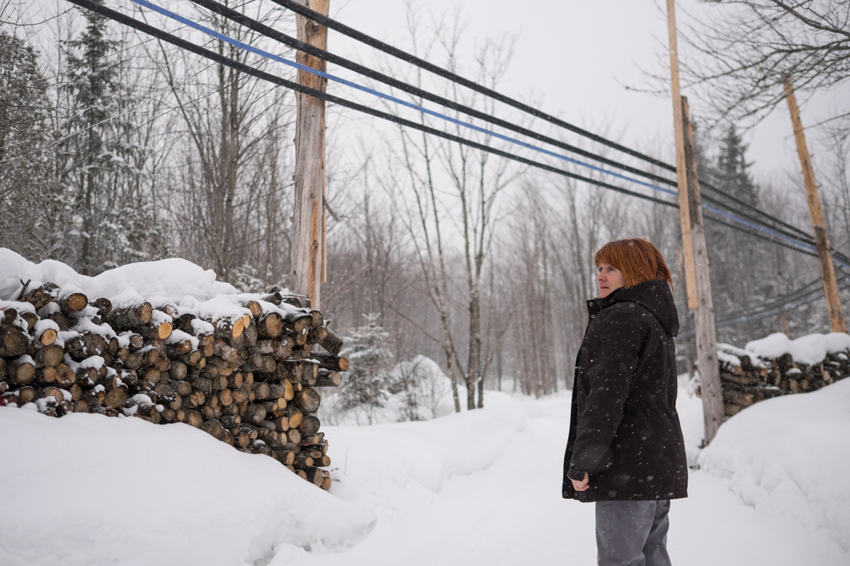 Angèle Grenier surveys the tubing that carries maple sap from the trees to collection barrels. There are more than two miles of tubing on her property.