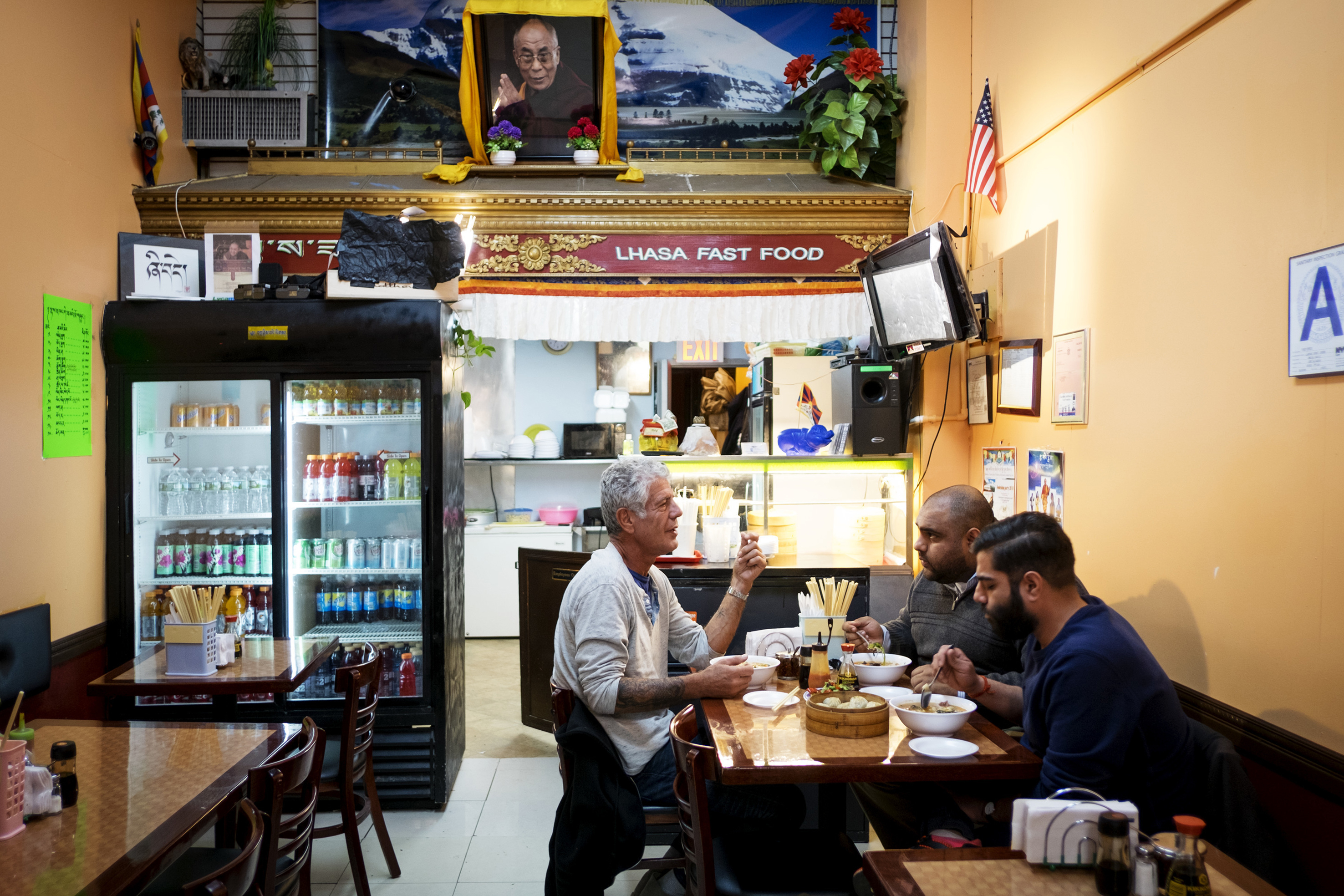 Bourdain with Ali Najmi and Heems at Lhasa Fast Food.