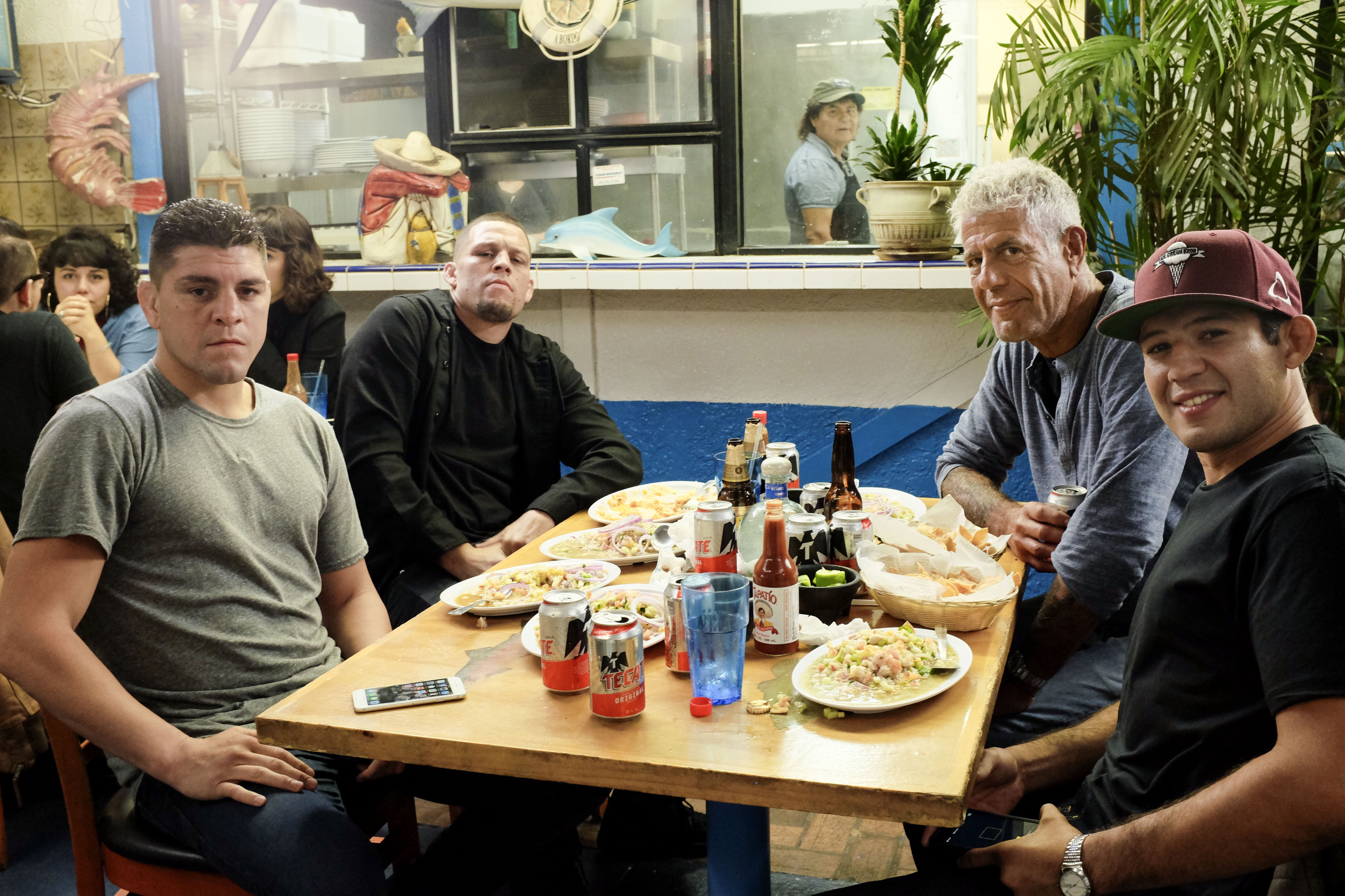 Bourdain with Nick and Nate Diaz, and Gilbert Melendez at Mariscos Chente.