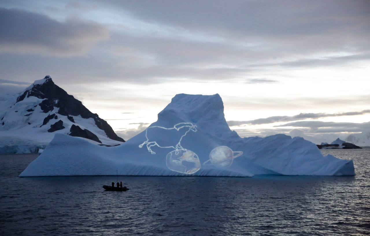 Video artist Alexis Anastasiou projected sketches of ancient rock paintings found in his native Brazil onto a towering iceberg.