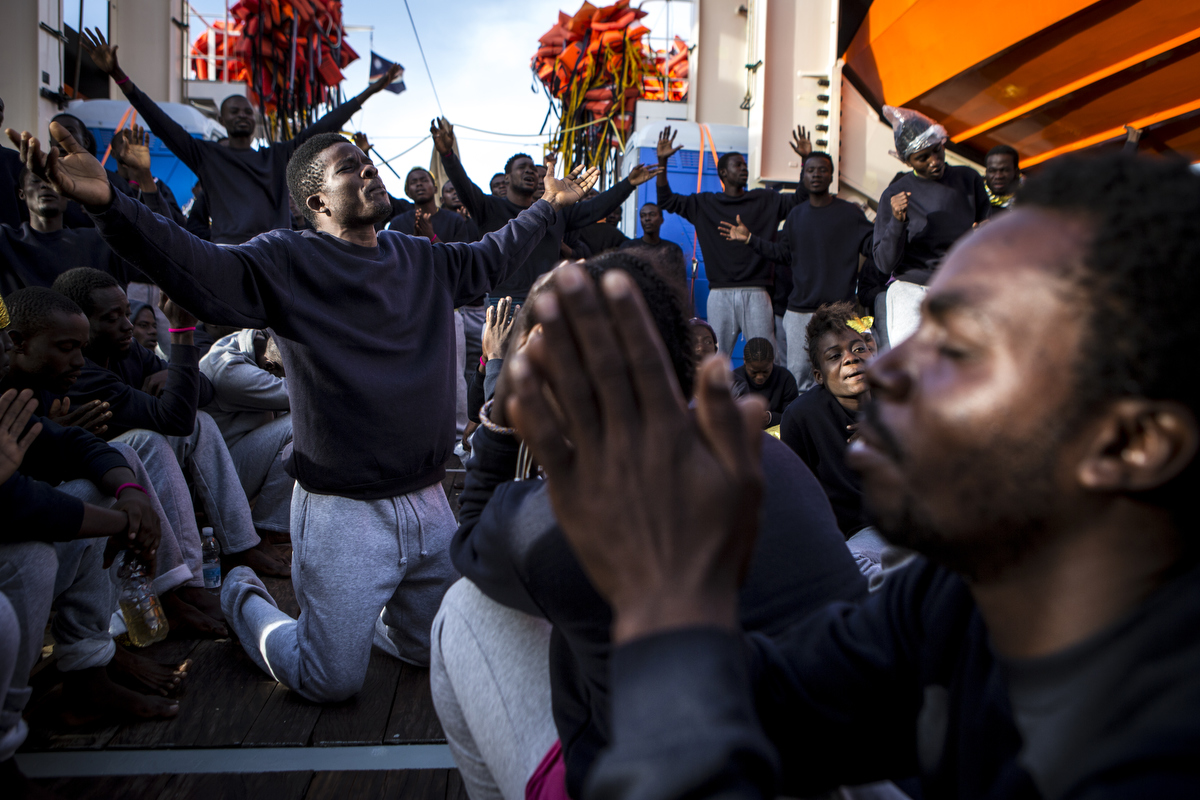 West Africans celebrate as they reach Sicily.