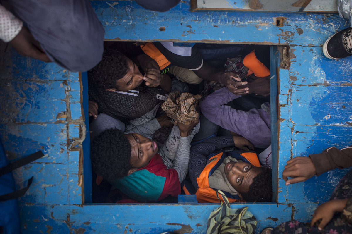 Inside the hold of a large wooden boat with about 400 Eritreans onboard.