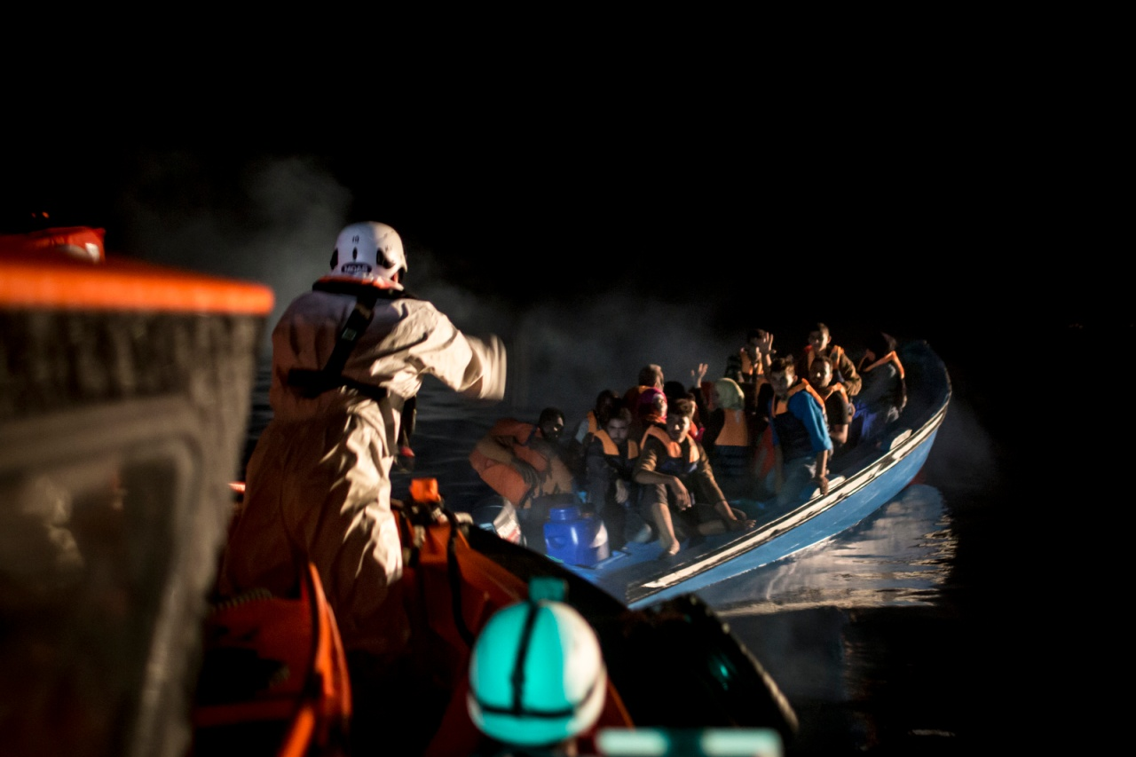 The Topaz approaches a boat during a rescue operation.