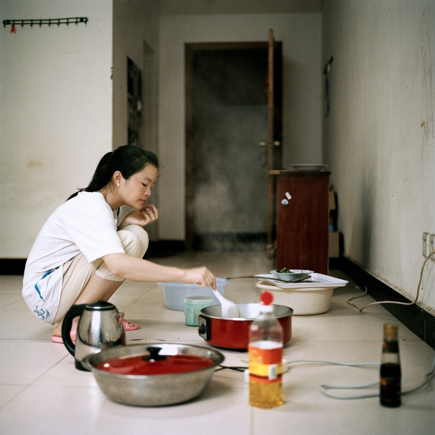 1. Most businesses in the city were run by merchants from China who have left. / 2. Jia Jia, a 25 year Laotian from the Luang Namtha Province, lives in one of the workers' quarters with her Chinese boyfriend.