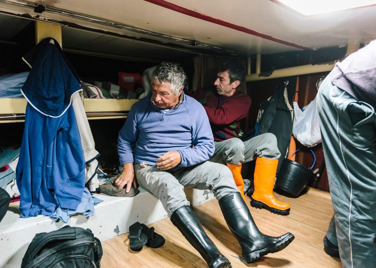Around 3 a.m., the crew aboard the Abraão Miguel gets ready for work.