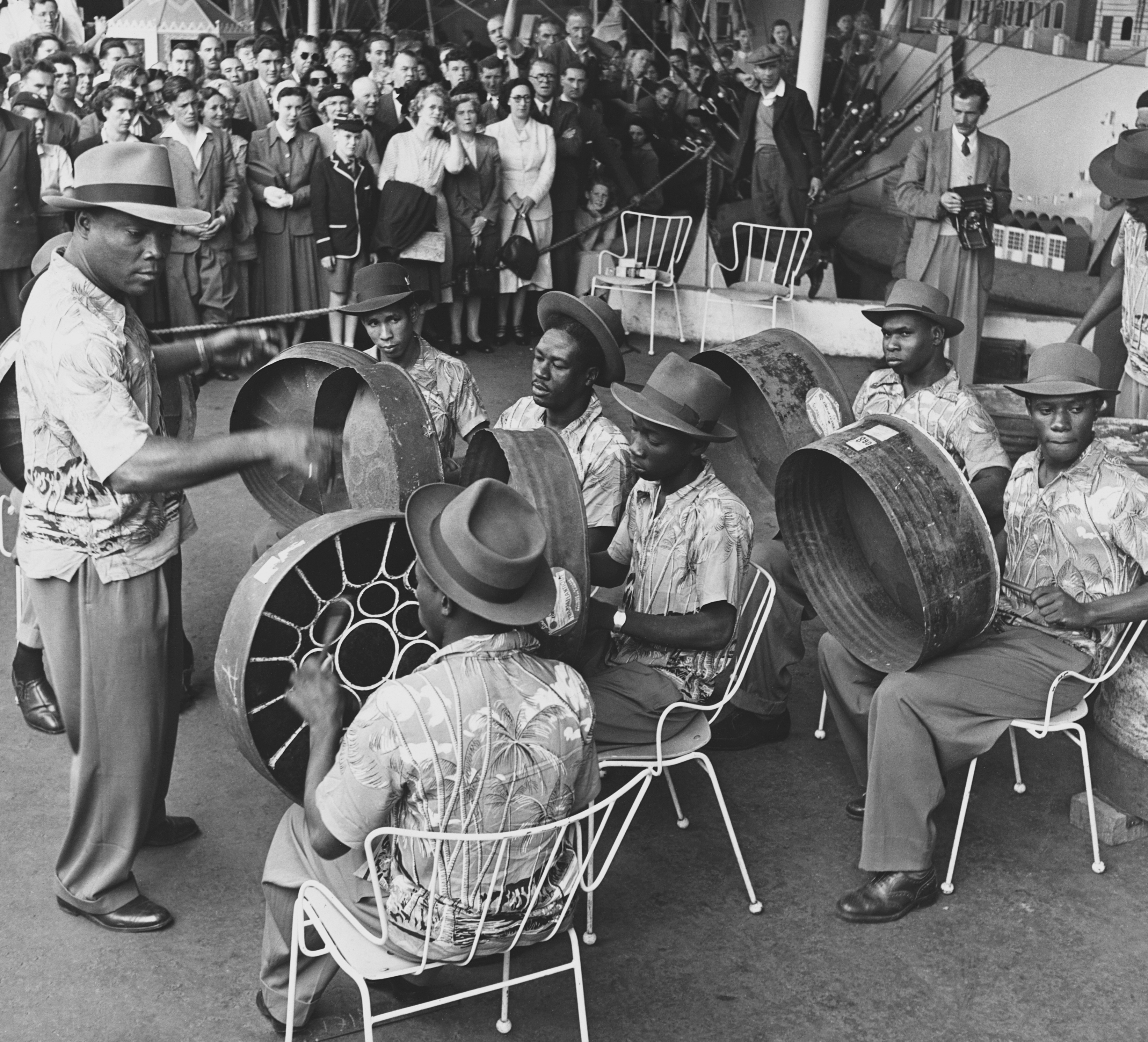 The Trinidad All Steel Percussion Orchestra, gives its first public performance in London at the South Bank under the leadership of their Manager, Joseph Griffith, a Lieutenant in the St. Lucia Police. (Photo by © Hulton-Deutsch Collection/CORBIS/Corbis via Getty Images)