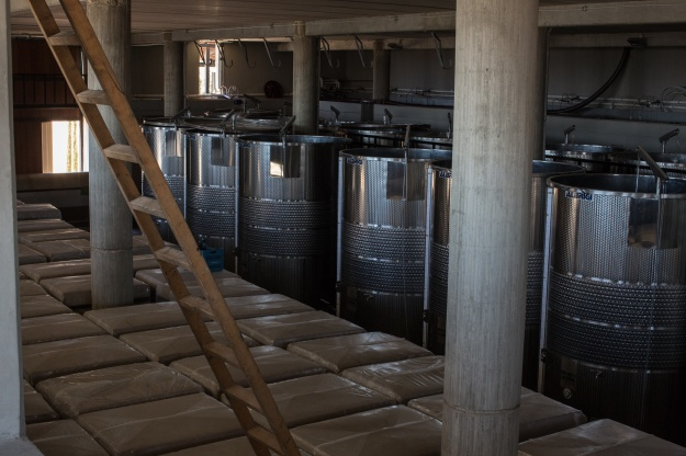 1. The view from the Couvent Rouge winery. / 2. Fermentation vats at the winery.