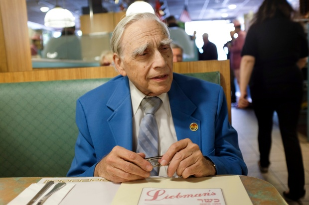 Lloyd Ultan awaits his meal at Liebman's.