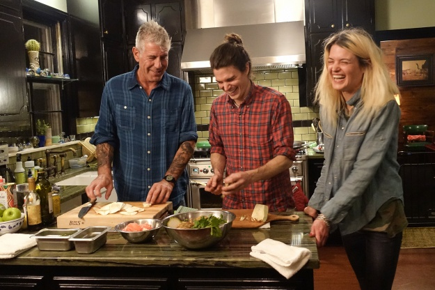 1. Backyard barbecue with Sean Brock, Tyler Brown, Pat Martin, and Tandy Wilson. / 2. Bourdain with siblings Matthew and Alison Mosshart.