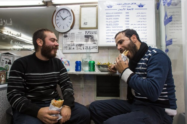 Two men chow down on Sahyoun's falafel.