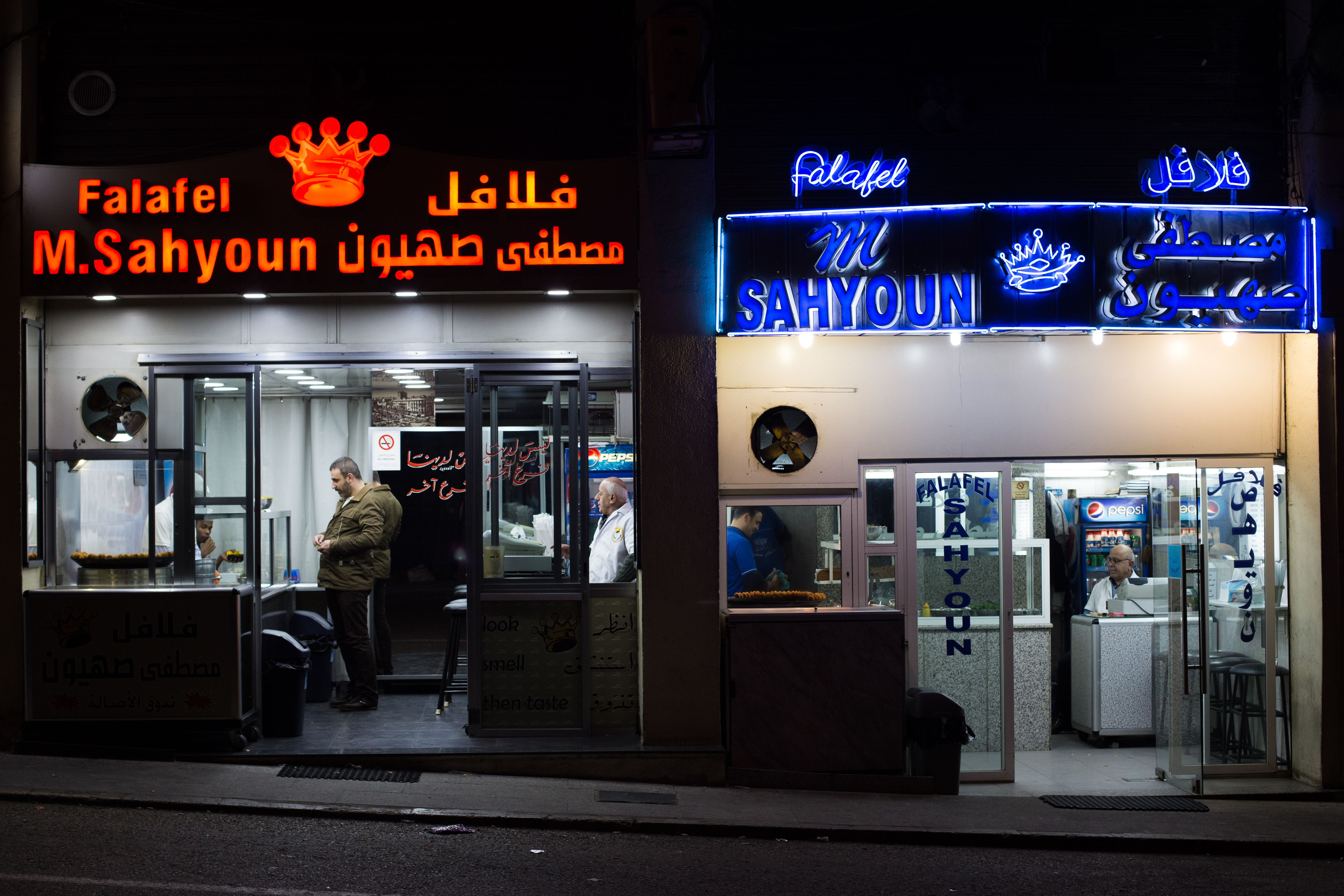 The original Sahyoun's falafel, right, is now run by Zouhair Sahyoun. He no longer speaks to his brother Fouad, who runs the red Falafel M. Sahyoun on the left.