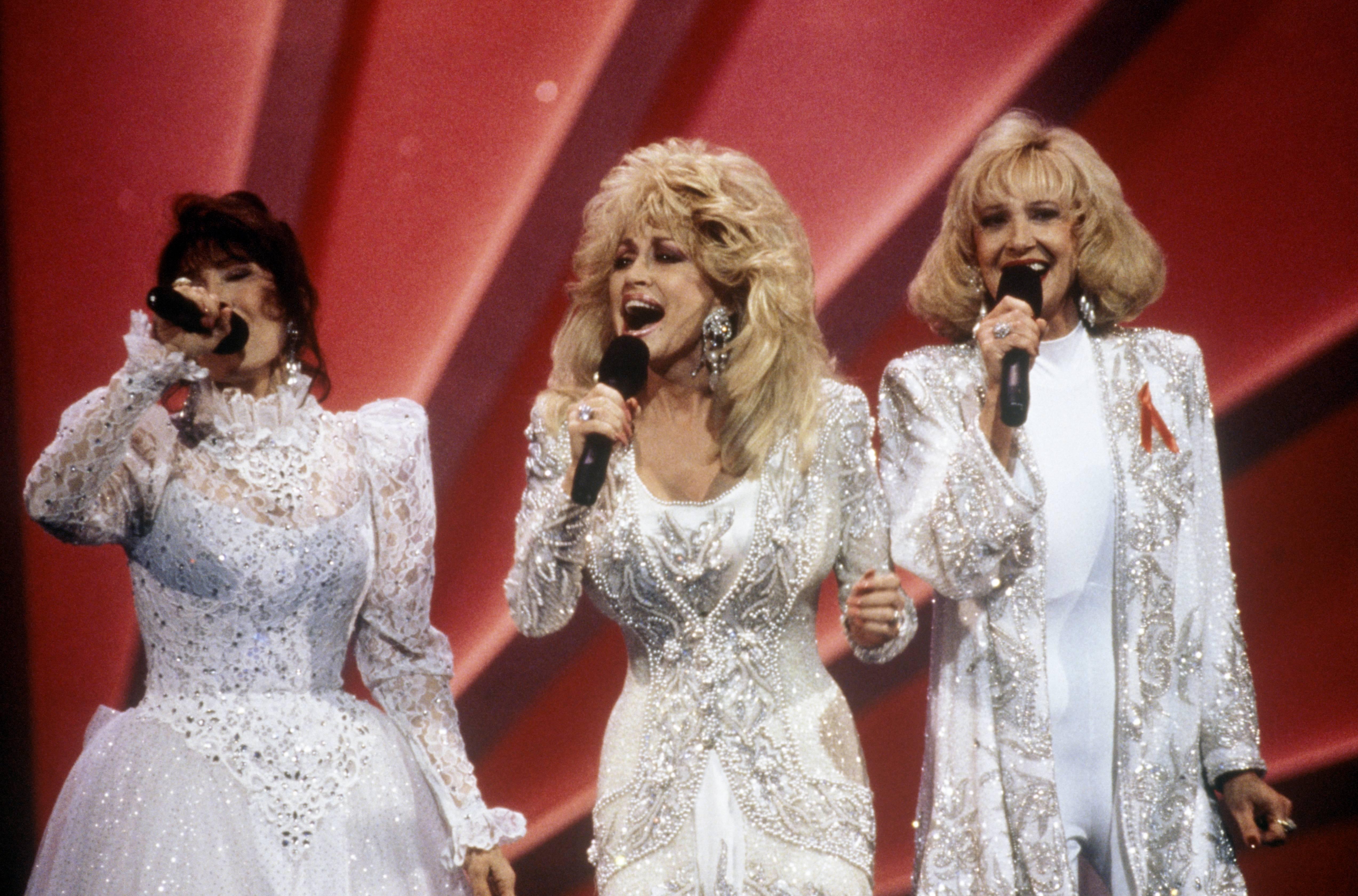 Loretta Lynn, Dolly Parton, and Tammy Wynette. (Photo by Beth Gwinn/Redferns)