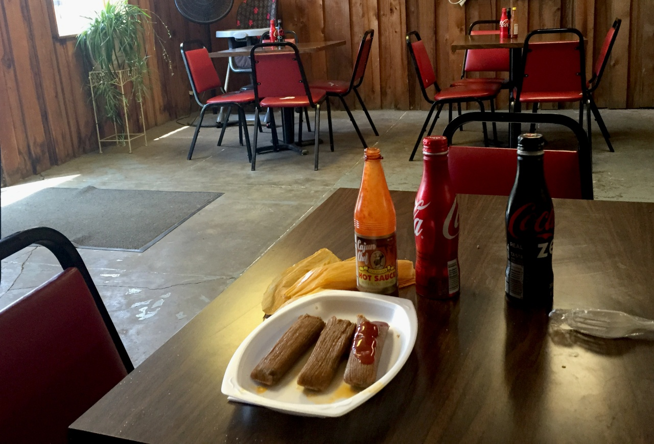 A plate of tamales served with Cajun Chef hot sauce inside Solly's in Vicksburg.