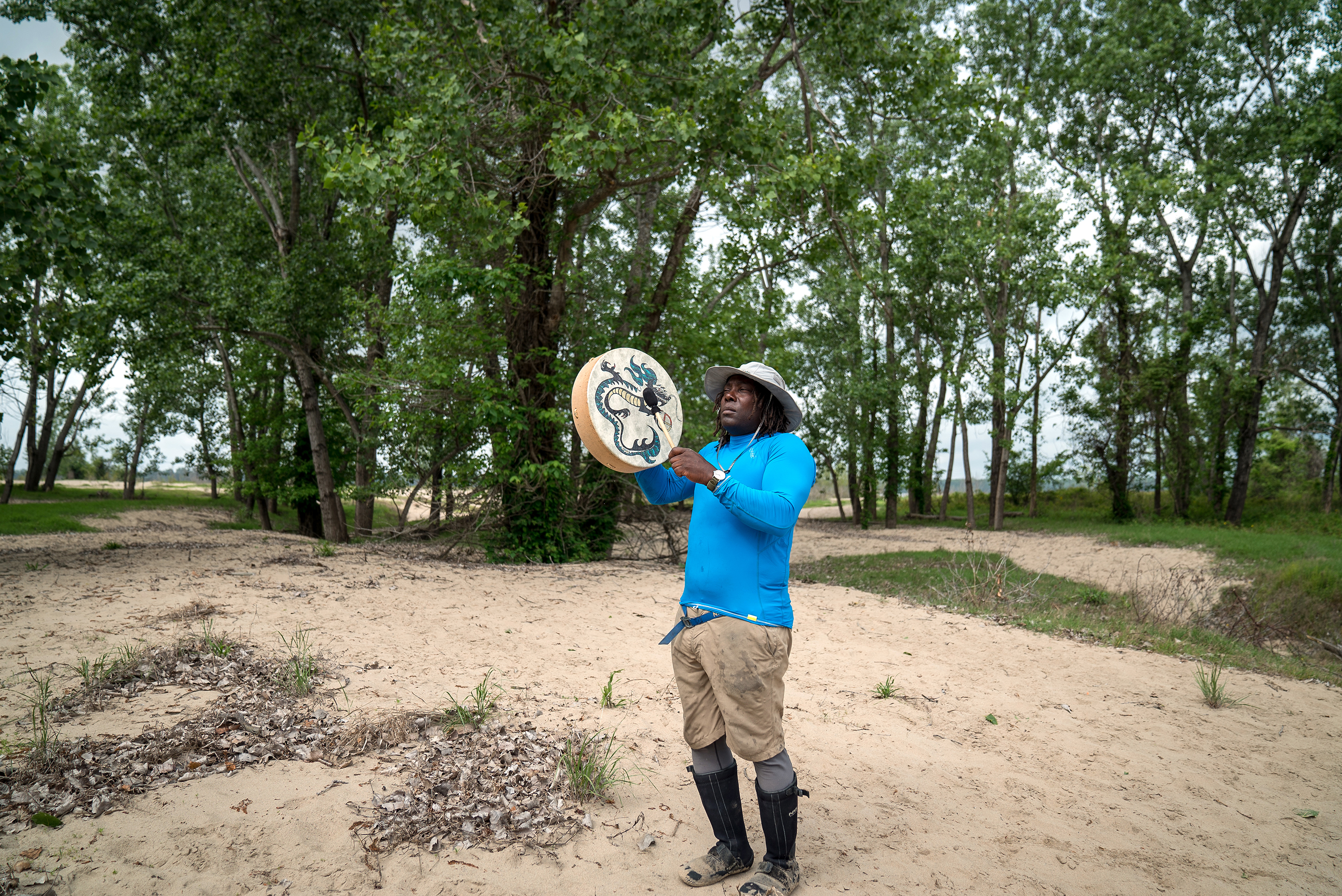 """1. Days on a river expedition often begin before sunrise. / 2. Mark """"River"""" Peoples, a river guide with the Quapaw Canoe Company, plays the hand drum during an Easter ceremony."""