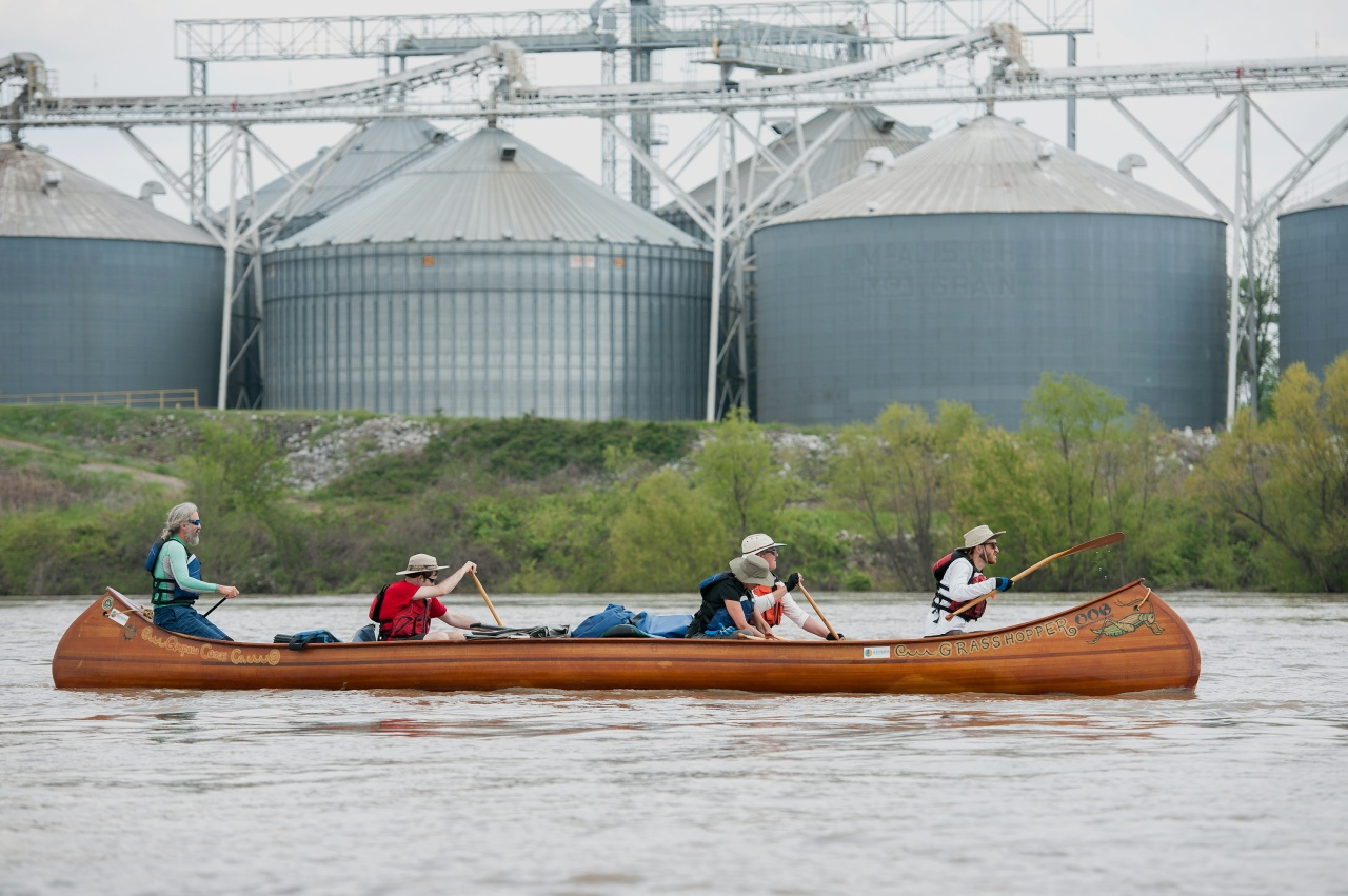 The crew—with the author in the bow and Ruskey in the stern—passes grain storage for the farms that sit alongside the river.