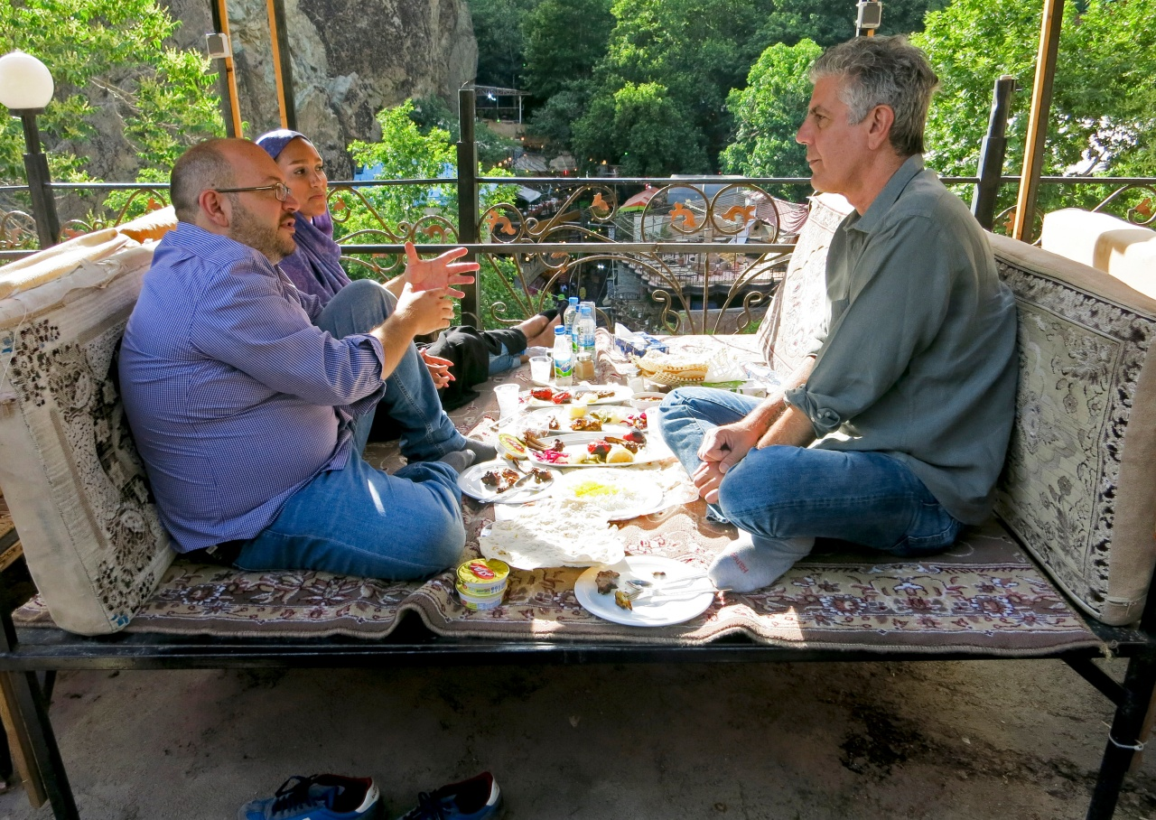 Jason and Yeganeh Rezaian sit with Bourdain up in the hills of Darband.