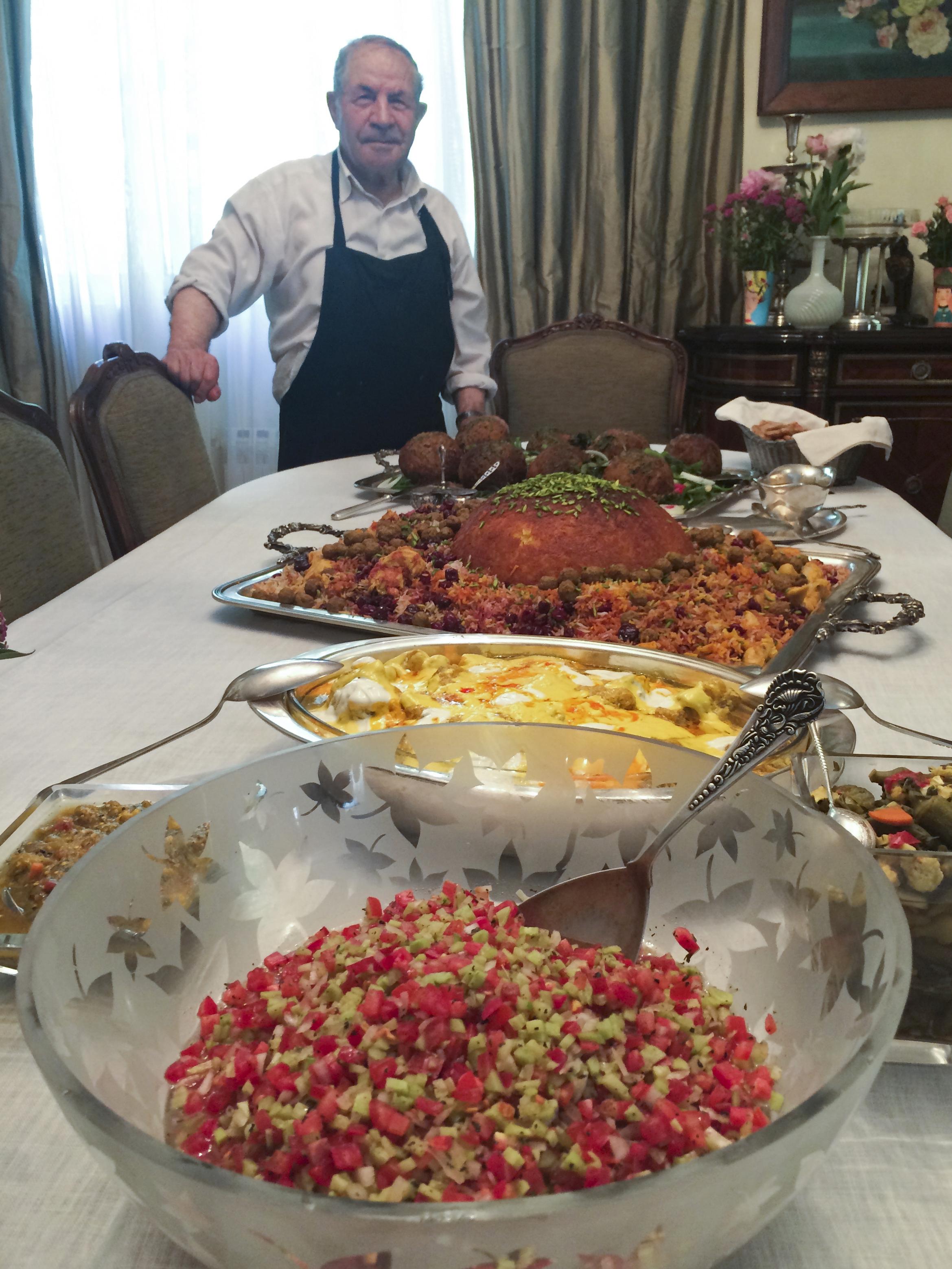 Nazila Noebashari's cook, Rahim, with the beautiful feast he created. (Photo by Erik Osterholm)