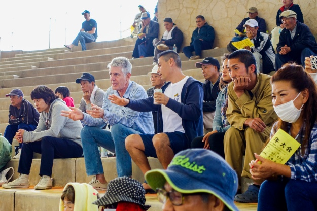 Bourdain watches the fight with Kenneth Ehman at the Ishikawa Dome in Uruma City.