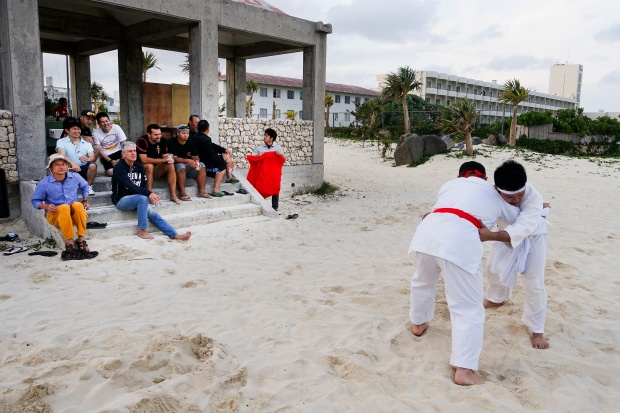 Bourdain watches Tegumi practice (Okinawan sumo wrestling) on Kume Island.