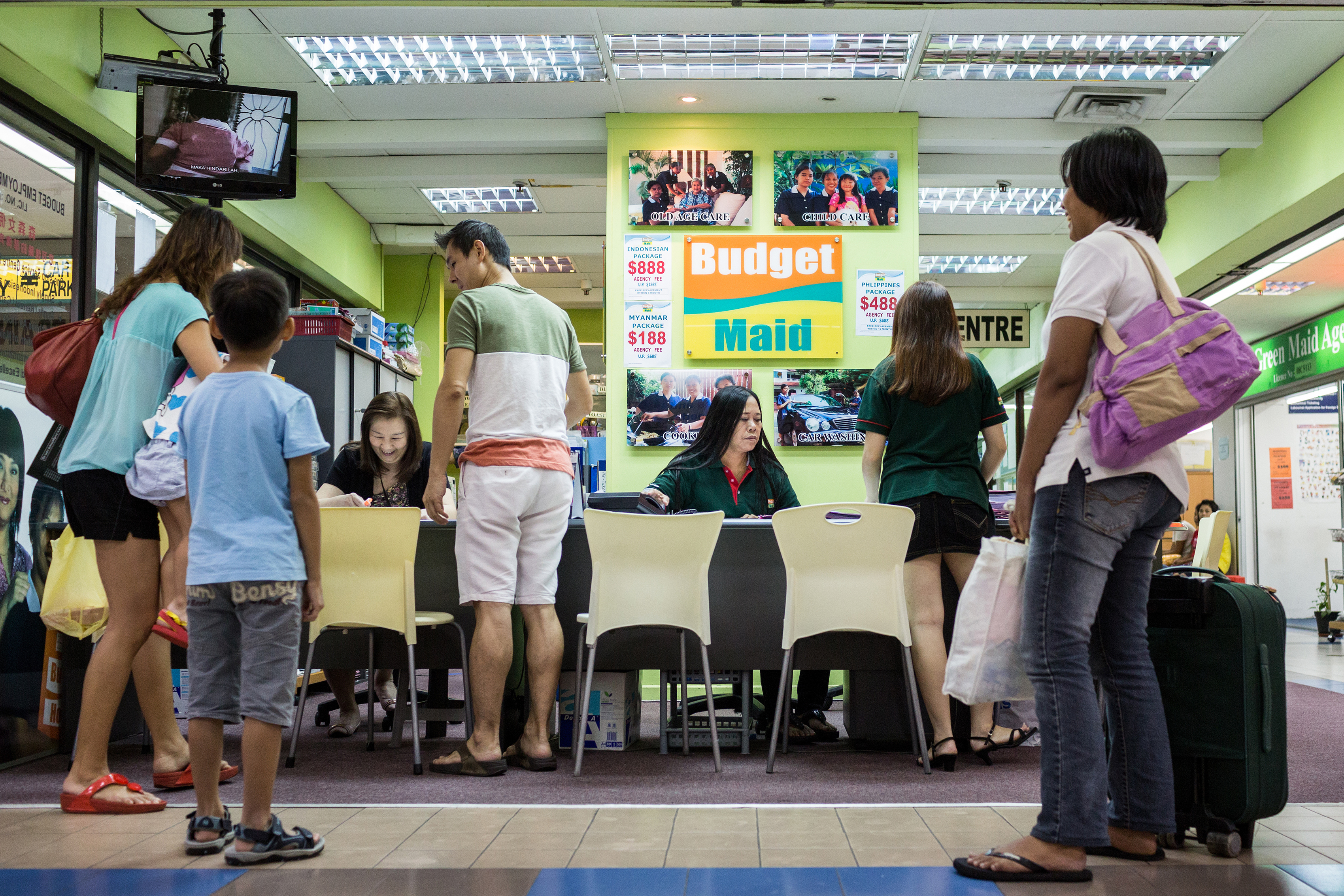 A family picks up their domestic workers at an agency in Bukit Timah shopping centre, Singapore.
