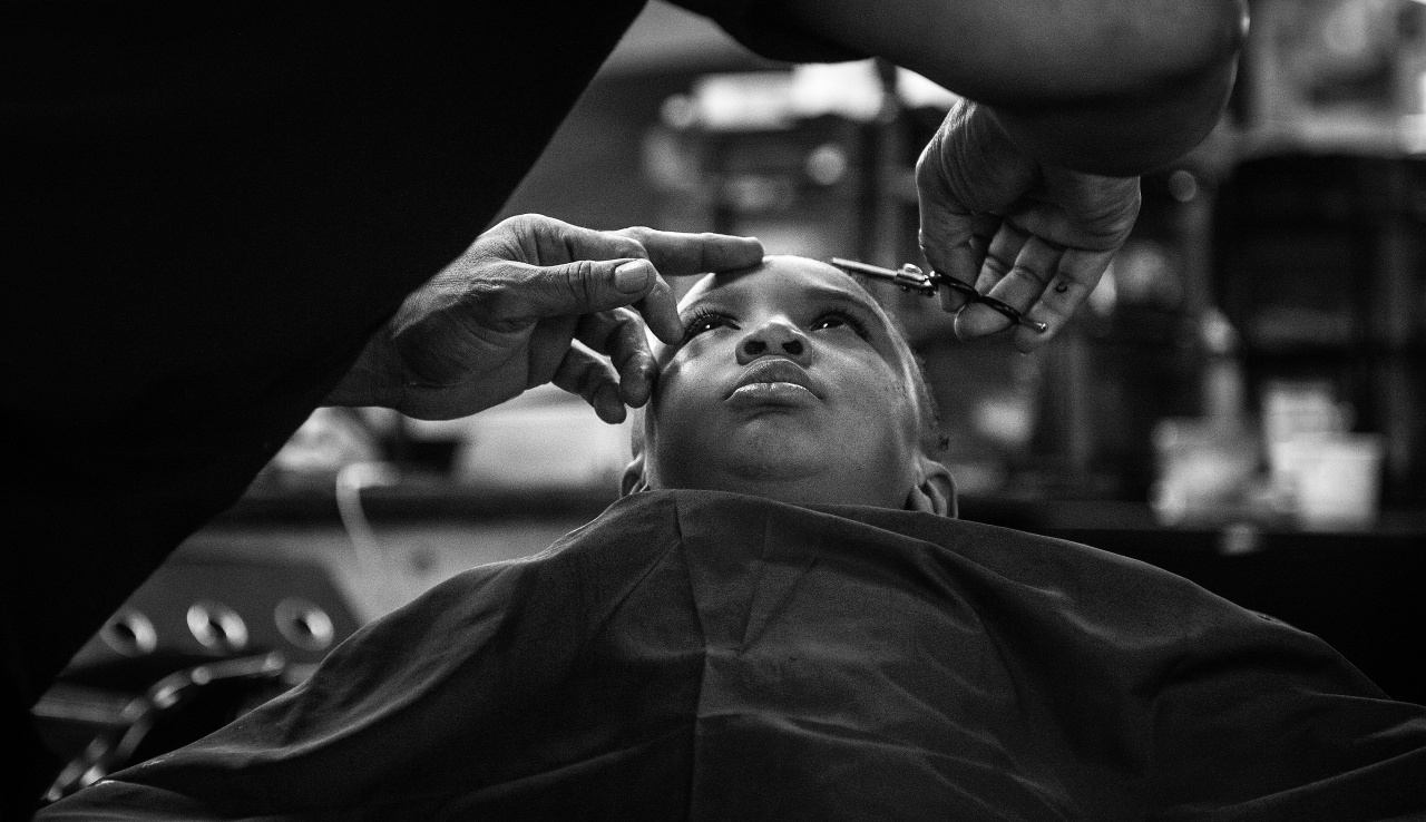 Noah Smith holds still as he receives a haircut at Dave's Barber Shop.