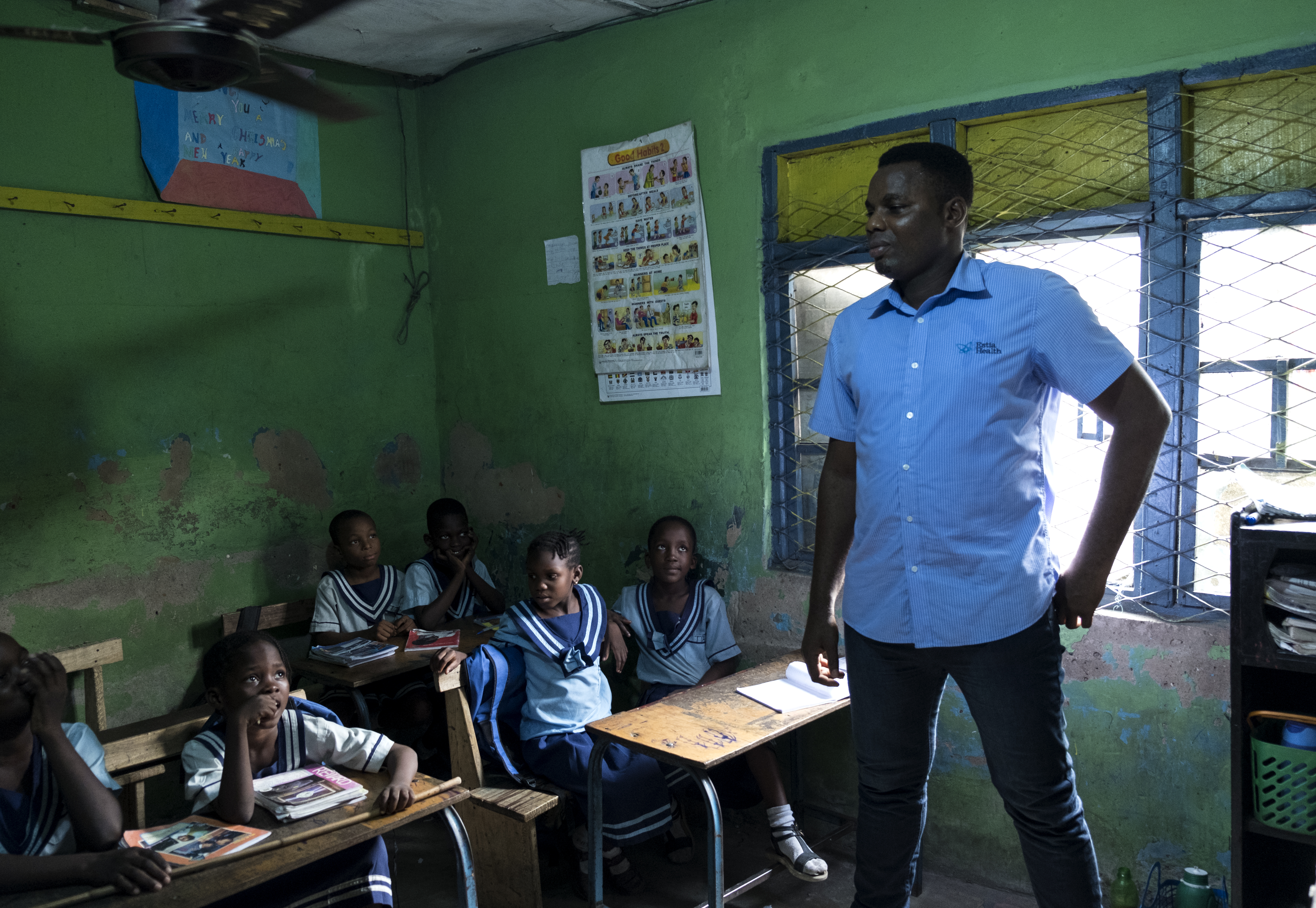 Eric Obuh gives a speech in a classroom in Lagos.