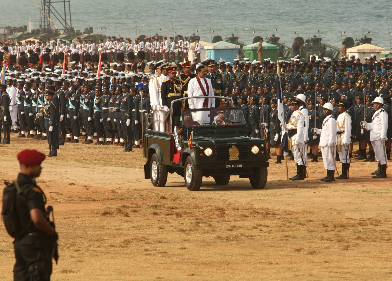 Sri Lankan president Mahinda Rajapaksa inspects the military parade commemorating the third anniversary of the end of the civil war on May 19, 2012 in Colombo. (Photo by Buddhika Weerasinghe via Getty Images)