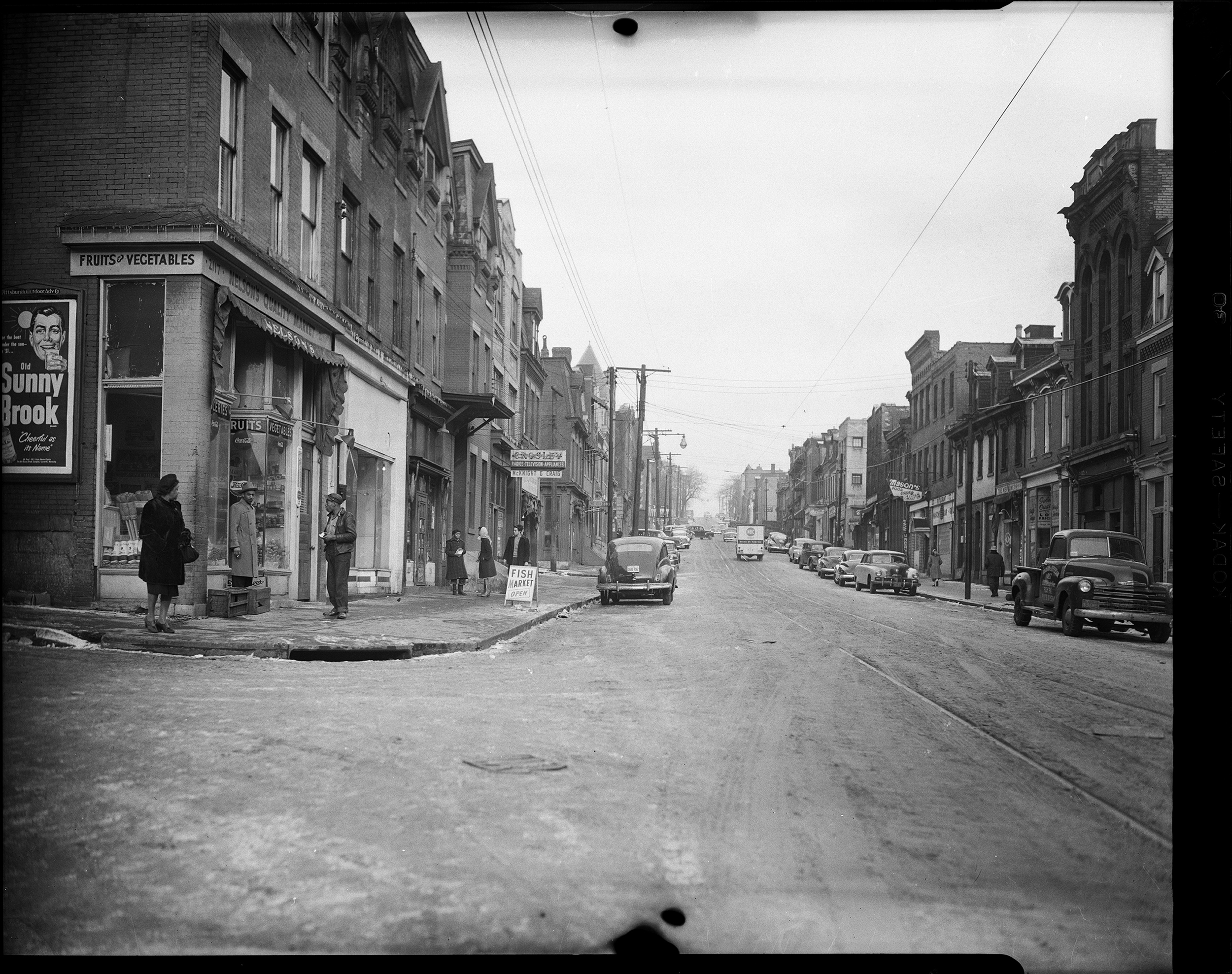 Nelson's Quality Market, Crosley Appliances, and Mason's Cafe on Wylie Avenue at the intersection of Trent Street in the Hill District. c. 1946 - 1960. (Photo by Charles 'Teenie' Harris/Carnegie Museum of Art via Getty Images)