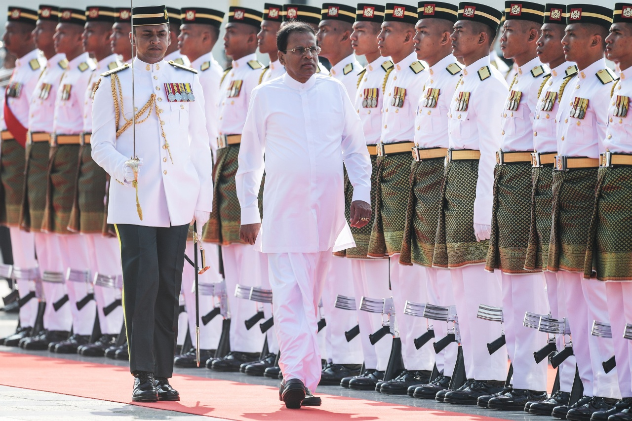 Sri Lankan President Maithripala Sirisena (C) inspects a guard of honour during a welcoming ceremony at the Malaysian prime minister's office in Putrajaya on December 16, 2016. Sirisena is here to hold talks with the Malaysian leadership on bilateral and international issues. (Photo by MOHD RASFAN/AFP via Getty Images)